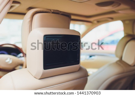 Close up shot of a small screen dvd player inside a car. Royalty-Free Stock Photo #1441370903