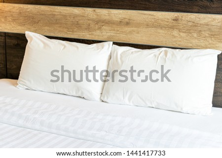 white comfortable pillows on bed #1441417733