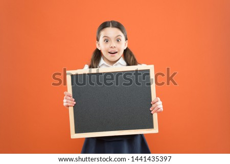 Good news for pupils community. Educational program. School schedule information. School girl cute pupil hold blackboard copy space. School announcement concept. Informing kids changes in school life. #1441435397