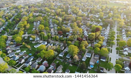 Aerial view of residential houses at spring (may). American neighborhood, suburb.  Real estate, drone shots, sunset, sunlight, from above.  #1441456364