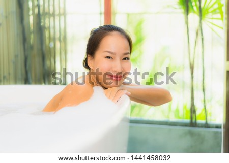Portrait young beautiful asian woman take a bath in bathtub for leisure relax and in bathroom interior #1441458032