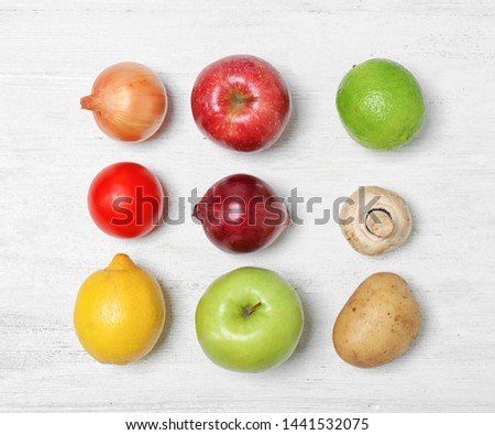Flat lay composition with ripe fruits and vegetables on white wooden table #1441532075