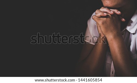 Christian life crisis prayer to god. Woman Pray for god blessing to wishing have a better life. woman hands praying to god with the bible. begging for forgiveness and believe in goodness. #1441605854