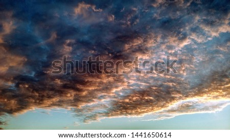 Dramatic clouds overhead at the evening #1441650614