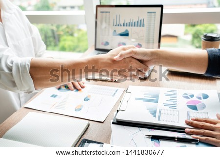 Business handshake after agreement meeting or negotiation finishing up dealing project, partnership approval and deal concept #1441830677