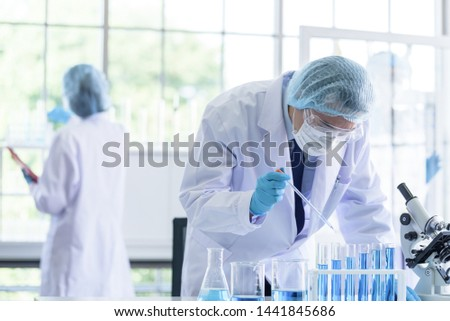 Asian scientist team has researching in laboratory. #1441845686