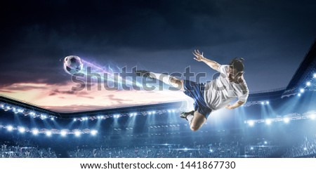 Soccer player on stadium in action. Mixed media #1441867730