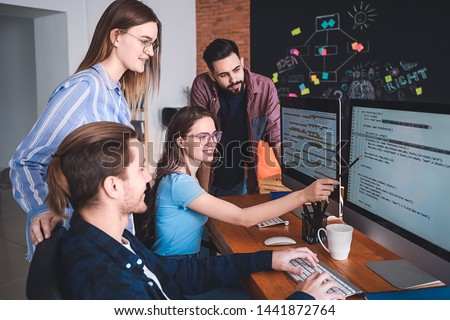Team of programmers working in office #1441872764