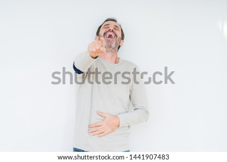 Elegant senior man over isolated background Laughing of you, pointing to the camera with finger hand over chest, shame expression #1441907483