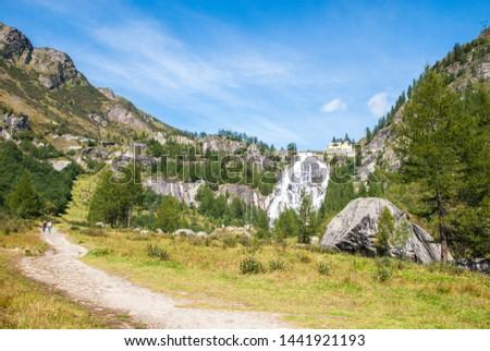 Waterfall Cascata del Toce in italian Alps near lake Maggiore, Formazza comune, Piedmont and Lombardy regions summer sunny day Italy #1441921193