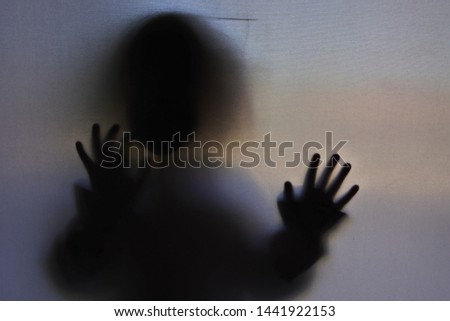 the mysterious silhouette of a child as an atmosphere of horror #1441922153