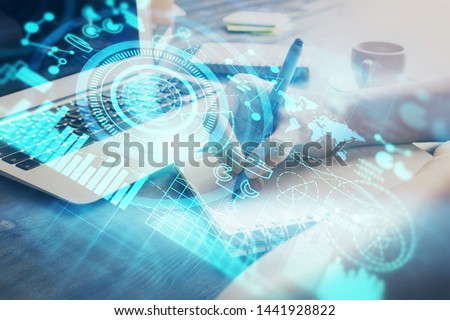 International business hologram over woman's hands taking notes background. Concept of success. Double exposure #1441928822