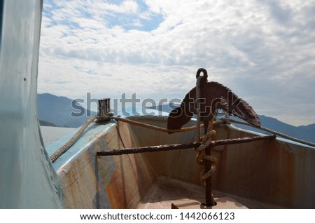 Nose of a ship with a rusty old anchor. Sea voyage on the South China Sea. Return to shore #1442066123