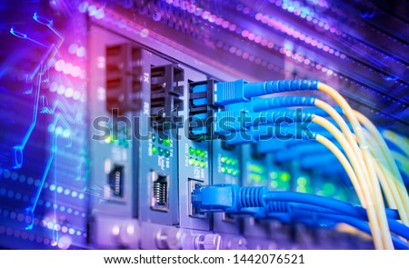 Fiber Optic cables connected to optic ports and UTP, Network cables connected to ethernet ports. #1442076521