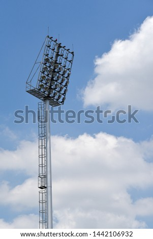 Spotlight pole and white clould and blue sky background #1442106932
