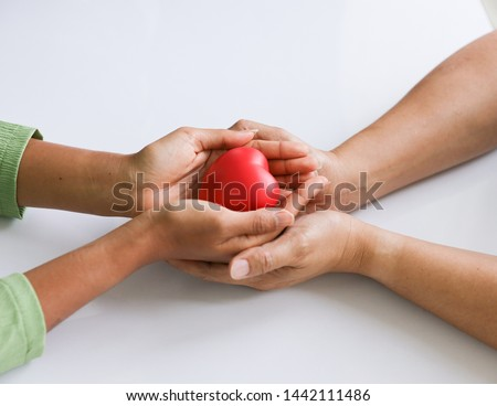 two asian hand man and woman meaning love each other holding red heart together planing build family getting married having many children buying big house in future dreaming for perfect life forever