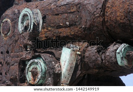 Detail of the back part of gun.You can see many textures and tones in the worn metal. Royalty-Free Stock Photo #1442149919