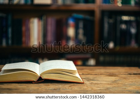 The book in the library (school, university, college) on the table. Reading, literature, learning and back to school concept. Copy space. #1442318360
