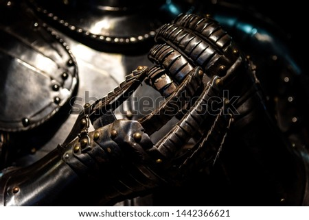 LONDON, ENGLAND, DECEMBER 10th, 2018: Henry VIII medieval armour suit and gauntlets shining in the dark #1442366621