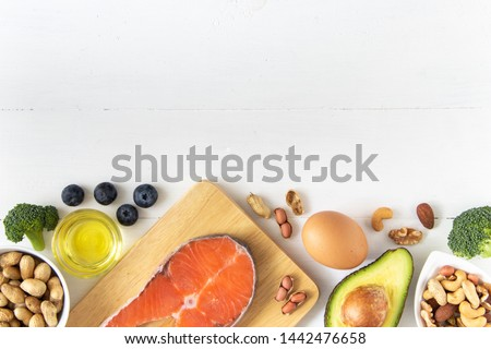 Top view of keto or ketogenic diet on white wooden background, low carb eating with high protein and good fat source #1442476658