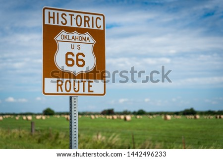 Historic brown and white sign on US Route 66 in Oklahoma Royalty-Free Stock Photo #1442496233