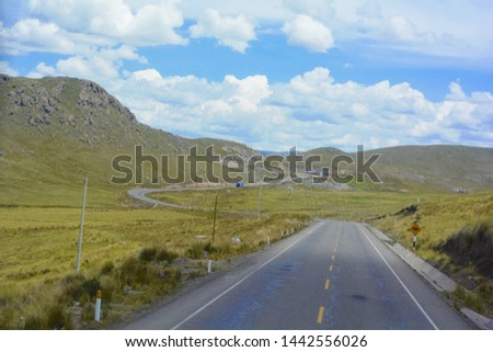 Beautiful summer landscape. Mountaing and endless road. #1442556026