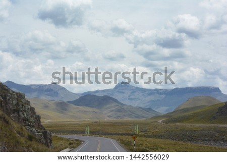 Beautiful summer landscape. Mountaing and endless road. #1442556029