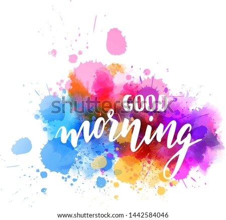 Good morning hand lettering phrase on watercolor imitation color splash.  Modern calligraphy inspirational quote.