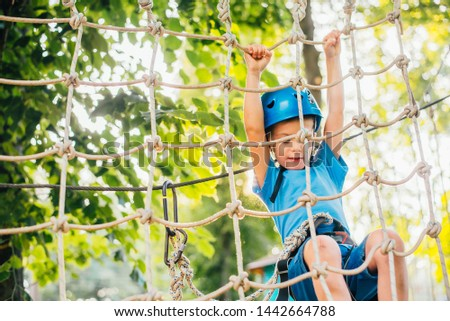 boy at climbing activity in high wire forest park #1442664788
