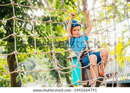 boy at climbing activity in high wire forest park #1442664791