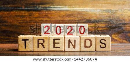 Wooden blocks with the word Trends 2020. Main trend of changing something. Popular and relevant topics. New ideological trends of fashion. Recent and latest trend. Evaluation methods. Fashionable Royalty-Free Stock Photo #1442736074