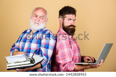 Modern life and remnants of past. Digital technologies. Battle of technologies. Master new technologies. Men work writing devices. Old generation. Senior man with typewriter and hipster with laptop. #1442808965