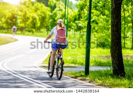 Cyclist ride on the bike path in the city Park #1442838164