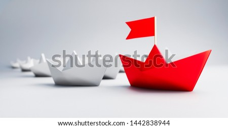 Red paperboat leading a group of white paperboats - 3D illustration #1442838944