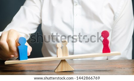 Wooden figures of people on scales. The court decision on custody of the children by one of the parents after the divorce. Deprivation of parental rights. Guardianship concept. Guardian #1442866769