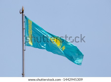 Flag of Kazakhstan against the background of the sky #1442945309