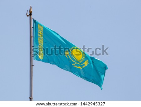 Flag of Kazakhstan against the background of the sky #1442945327