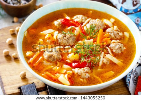 Homemade Hot Soup close-up with pasta, turkey meatballs and Peas Chickpeas. Eastern cuisine. The concept of healthy eating. #1443055250