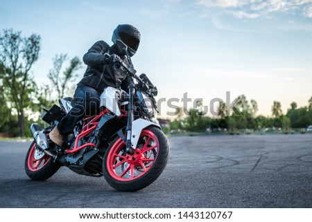 biker rides motorcycle, turns, bright colors motorcycle, sports fast motorcycle #1443120767