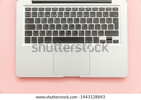 Keyboard laptop computer isolated on pink pastel desk background. Modern Information technology and sofware advances. Freelance home office programmer or designer workspace concept #1443128843