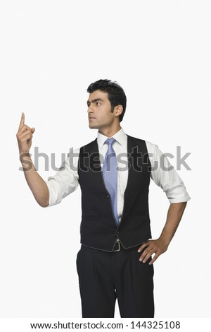 Businessman pointing upwards #144325108