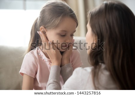 Loving young mother touching upset little daughter face, expressing support, young mum comforting offended adorable preschool girl, showing love and care, child psychologist concept, close up #1443257816