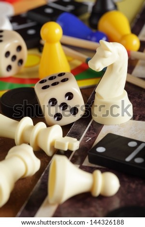 Detail of board games, pawns, chessmen, dominoes and dices. #144326188