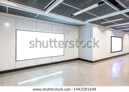 Blank advertising display in subway station underpass public area