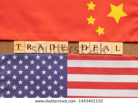 Concept of China US Trade deal, Trade Deal Printed on Wooden block letters in between China and US Flags. #1443401150