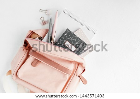 Backpack with school supplies and books for study. Back to school concept. Flat lay, top view  Royalty-Free Stock Photo #1443571403