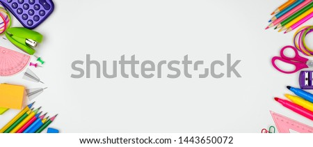 School supplies double side border banner. Top view on a white background with copy space. Back to school concept.