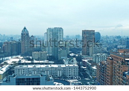 Snow city. City with high-rise buildings. A populous city. Kiev, Ukraine, winter, 2019. #1443752900