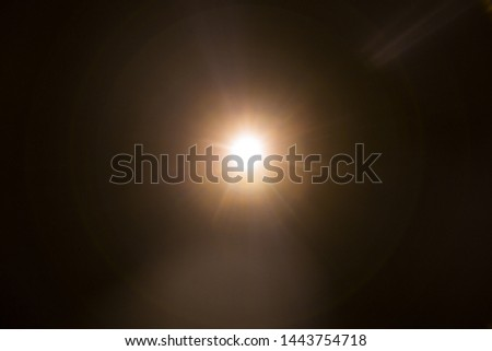 Abstract Natural Sun flare on the black #1443754718