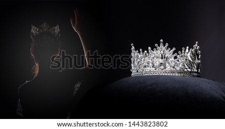 Diamond Silver Crown for Miss Pageant Beauty Contest, Crystal Tiara jewelry decorated gems stone and abstract dark background on black velvet fabric cloth, Macro photography copy space for text logo #1443823802